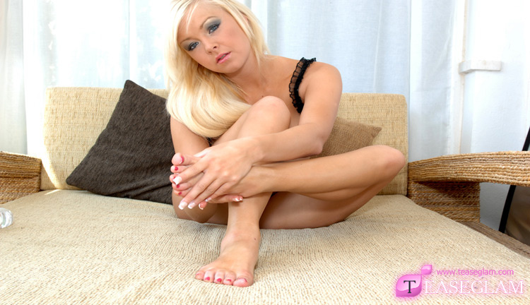 Morgan drizzles baby oil all over her feet